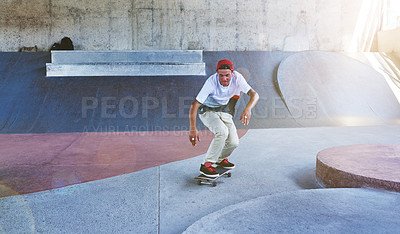 Buy stock photo Shot of a young man skating at a skatepark
