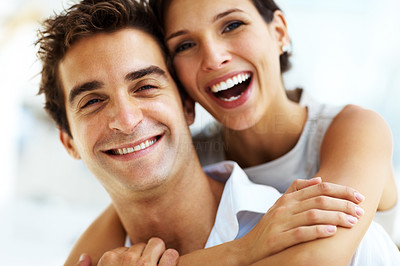 Buy stock photo Closeup portrait of smiling young woman embracing her handsome boyfriend