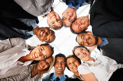 Buy stock photo Low angle view of colleagues looking down and smiling