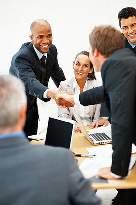 Buy stock photo Two colleagues shaking hands during meeting