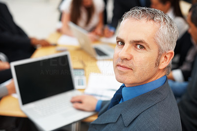 Buy stock photo Confident male executive with laptop during meeting