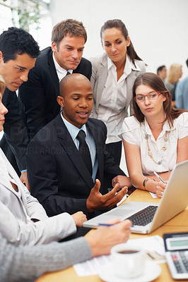 Buy stock photo Group of executives viewing proposal on laptop