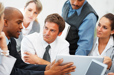 Buy stock photo Focus on executive sharing ideas with colleagues listening