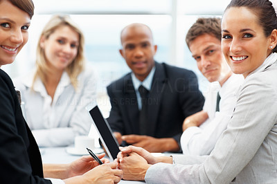Buy stock photo Focus on two female executives with colleagues in background