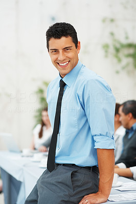 Buy stock photo Portrait of smart business man sitting on table during meeting