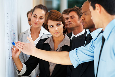 Buy stock photo Colleagues discussing business graph