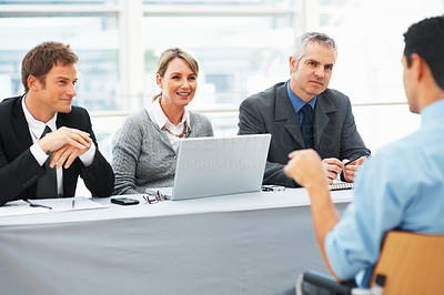 Buy stock photo Panel of interviewers interviewing a man