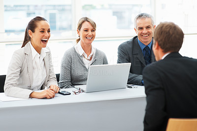 Buy stock photo Cheerful executives interviewing a man