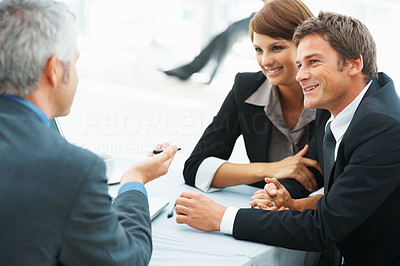 Buy stock photo Business couple taking advice from business consultant