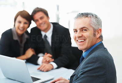 Buy stock photo Focus on mature business man smiling during meeting