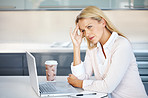 Tension - Business woman with hand on head at work