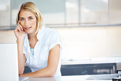 Buy stock photo Portrait of a beautiful businesswoman sitting at her desk with a laptop at office - Copyspace
