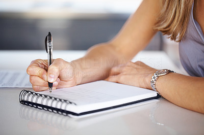 Buy stock photo Cropped image of woman's hand with pen writing down notes