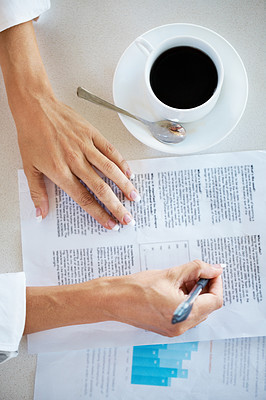 Buy stock photo Woman hand signing on some document with cup of coffee