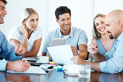 Buy stock photo Smiling business people with paper work in board room - Staff meeting