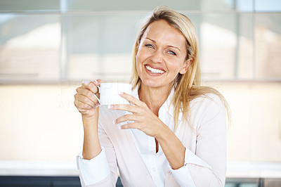 Buy stock photo Portrait of a smiling young casual businesswoman driking coffee