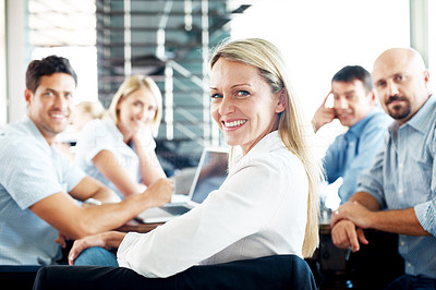 Buy stock photo Portrait of a beautiful young businessman glancing back while meeting - Group discussion