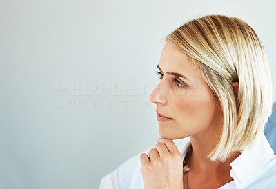 Buy stock photo Portrait of a beautiful young woman looking away at copyspace against grey background
