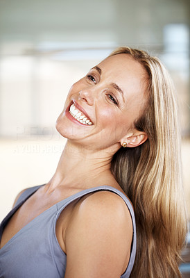 Buy stock photo Portrait of a happy young woman looking away and smiling