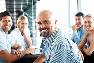 Buy stock photo Portrait of successful businessman in a business meeting smiling with colleagues