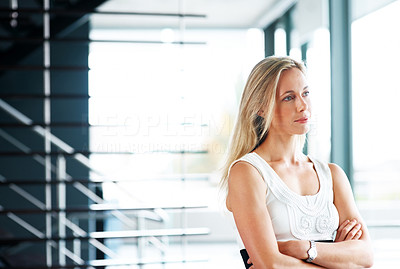 Buy stock photo Portrait of a pretty young woman standing with her hands folded and looking away - Copyspace