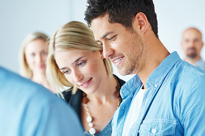 Buy stock photo Portrait of young couple among some people in a meeting
