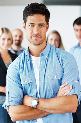 Buy stock photo Portrait of a smart young business man standing with folded hand at office