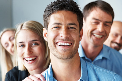 Buy stock photo Portrait of a happy young male business leader standing in front of his team - Teamwork