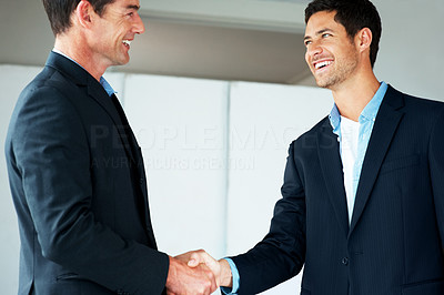 Buy stock photo Portrait of two happy business men shaking hands with each other in office