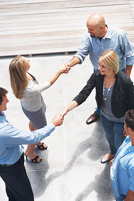 Buy stock photo Top view of successful business professionals shaking hands with each other