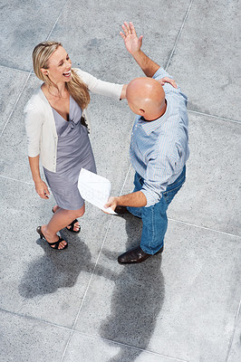 Buy stock photo A high angle view of two coworkers laughing