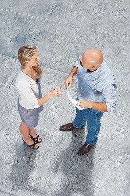Buy stock photo Top view of two business man and woman standing together and discussing something