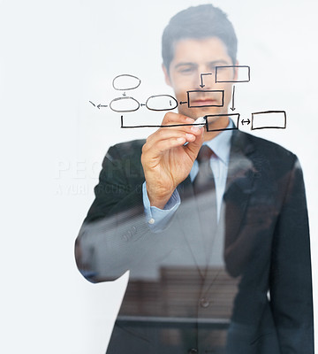 Buy stock photo A young executive drawing a diagram representing the facets of his business