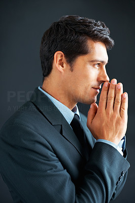 Buy stock photo Profile shot of professional man holding hands up to face