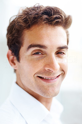 Buy stock photo Portrait of handsome young man smiling