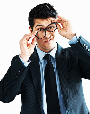 Buy stock photo Businessman adjusting his glasses humourously on white background - copyspace