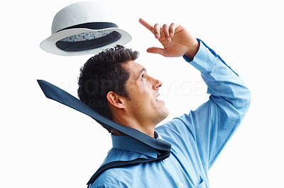 Buy stock photo Handsome business man with wind knocking hat of his head