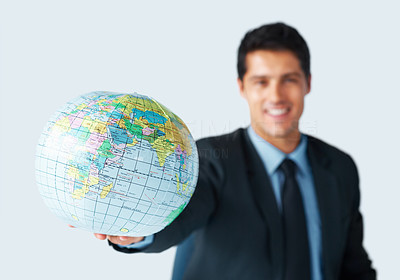 Buy stock photo Focus on globe with businessman in background