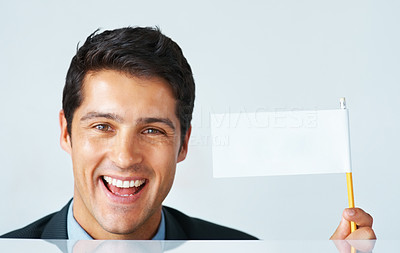 Buy stock photo Closeup of businessman holding up white flag spelling success