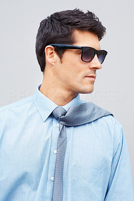 Buy stock photo Closeup of confident male executive in sunglasses posing