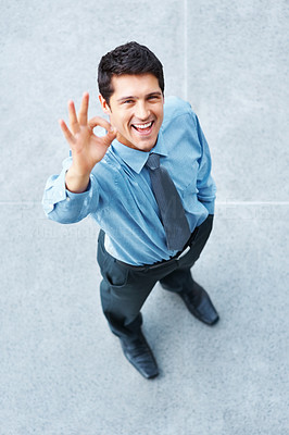 Buy stock photo Top view of executive outside, giving ok sign