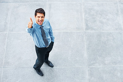 Buy stock photo Top view of executive outside, giving thumbs up