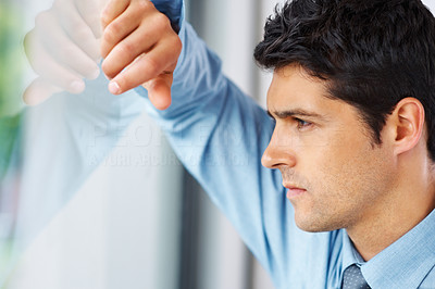 Buy stock photo Side view of a handsome businessman looking out of a window, deep in thought - copyspace