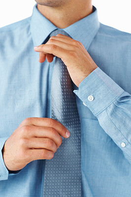 Buy stock photo Cropped image of businessman adjusting his tie