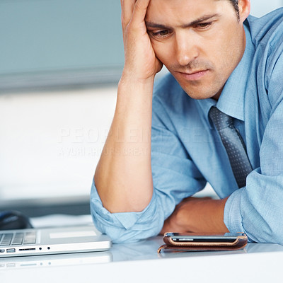 Buy stock photo Businessman sitting in front of laptop with hand on forehead