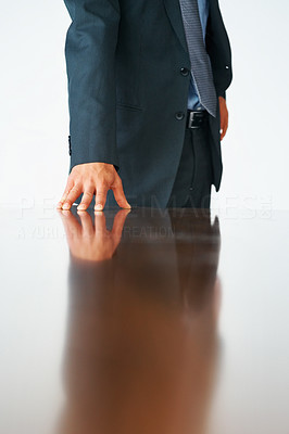 Buy stock photo Cropped image of businessman's hand on board room table