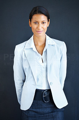 Buy stock photo View of business woman standing with hands behind her back