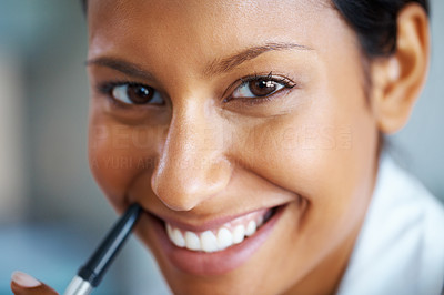 Buy stock photo Closeup view of pretty woman holding pen to mouth