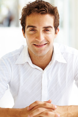 Buy stock photo Portrait of casual young guy smiling and looking at you