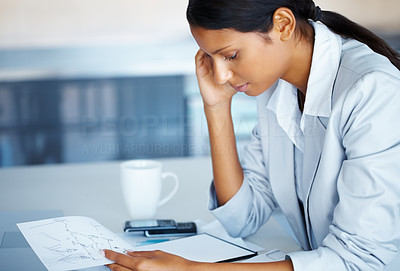 Buy stock photo Pretty business woman sitting at table, looking at notebook